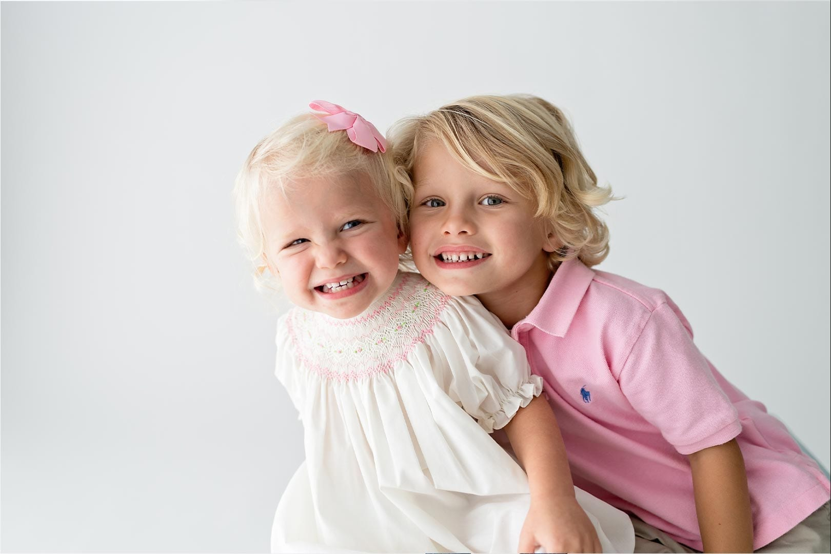 photo of a little boy and girl smiling