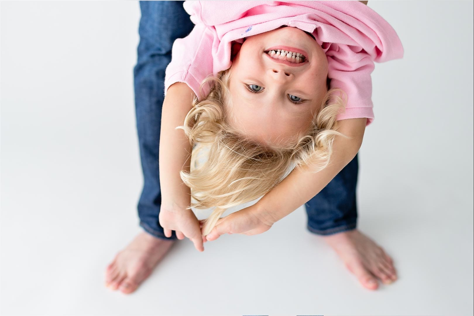 little girl smiling in upside down position